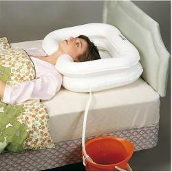 Lavacabezas hinchable para la cama